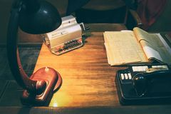 Design working office: antique table and analog telephone, lamp on table. stock images