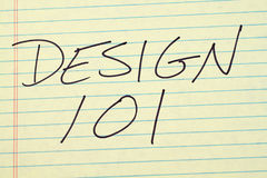 Design 101 On A Yellow Legal Pad. The words `Design 101` on a yellow legal pad Royalty Free Stock Photos