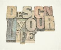 Design your life word abstract. Design your life - motivational advice - isolated word abstract in mixed vintage letterpress printing blocks, digital painting royalty free stock image