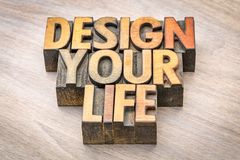 Design your life word abstract in wood type. Design your life - self development concept - word abstract in vintage letterpress wood type printing blocks Stock Photos
