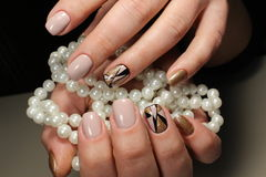 Design of youth manicure with pearls royalty free stock photo