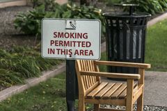 Designated smoking area Outdoor bench smoking zone permitted Royalty Free Stock Images