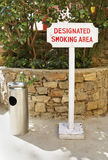 Designated smoking area sign ashtray Stock Photos