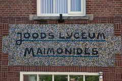 Designation Jewish Lyceum Maimonides on the facade Royalty Free Stock Photos