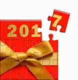 Designbegrepp för lyckligt nytt år 2017 med det röda pusslet för gåvaask Arkivbild