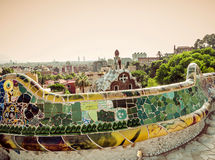 Designed by Antoni Gaudi in Barcelona. Mosaic in the park Guell, Barcelona. Catalonia. Spain Vintage retro style royalty free stock photo