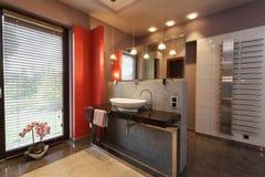 Designed bathroom with a vessel sink. Designed bathroom with a white ceramic vessel sink royalty free stock image