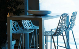 Designed chair and table in modern restaurant Royalty Free Stock Image