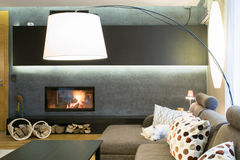 Designed lamp in living room. Designed lamp in modern luxury living room Royalty Free Stock Photography
