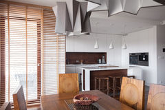 Designed lamp in modern kitchen. In wooden house Stock Photos