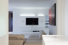 Designed living room with tv. Interior of designed living room with tv Royalty Free Stock Photos