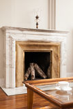 Designed marble fireplace. In luxury living room Stock Photos