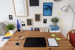 Designed modern workspace. Laptop on the desk in designed modern workspace Stock Photography