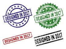 Grunge Textured DESIGNED IN 2017 Stamp Seals. DESIGNED IN 2017 seal prints with corroded style. Black, green,red,blue vector rubber prints of DESIGNED IN 2017 stock illustration