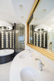 Designed shower in gleaming bathroom. Close-up of designed shower in gleaming bathroom royalty free stock image