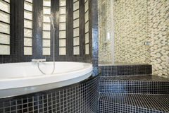 Designed shower in gleaming bathroom. Close-up of designed shower in gleaming bathroom stock photography
