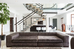 Designed sofa in expensive house. View of designed sofa in expensive house Stock Photos