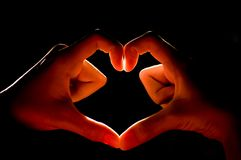 Designed to heart shape. The Photo heart shape design hand  background Royalty Free Stock Image