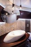 Designed washbasin in modern bathroom. Close-up of designed washbasin in modern bathroom royalty free stock photo