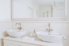 Designed washbasins in retro bathroom Stock Images