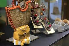 Designer accessories in store window stock image