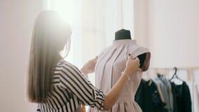 The designer adjusts sleeve blouse. The designer adjusts sleeve blouse stock footage