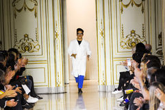 Designer Andres Caballero acknowledges the applause of the audience after the San Andres Milano fashion show Royalty Free Stock Photo