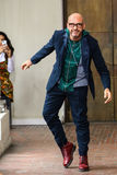 Designer Antonio Marras acknowledges the applause of the audience after I'M Isola Marras show Royalty Free Stock Image