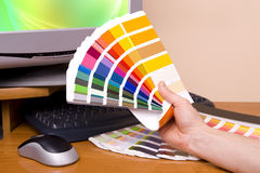 Designer Artist. Designer at work. Color samples on table stock photography
