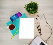 Designer, artist workplace. Creative, trendy,artistic mock up with paper, coffee,notebook or keyboard, earphones, a yellow pencil, royalty free stock photo