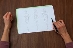 Designer assessing fashion drawings Stock Images