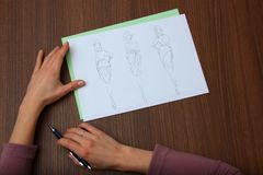 Designer assessing fashion drawings Royalty Free Stock Photography