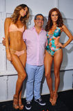 Designer Augusto Hanimian and models posing backstage at the Luli Fama fashion show during MBFW Swim 2015. MIAMI, FL - JULY 20: Designer Augusto Hanimian and Royalty Free Stock Images