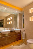 Designer Bathroom. Modern bathroom featuring his and hers sinks with uplighting and under cupboard lighting Stock Image