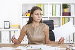 Designer in beige at work Stock Photos