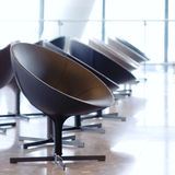 Designer chairs in airport. Waiting lounge in Heathrow airport, Great Britain Royalty Free Stock Photo