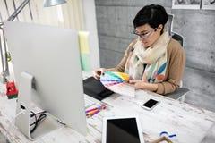 Designer choose color palette for work Stock Images