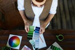 Designer Choosing Color Palette for Project Stock Photos
