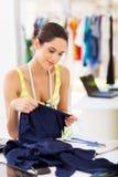 Designer choosing fabric Royalty Free Stock Photography