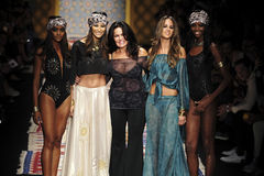 Designer Christina Ferrari (C) and models pose on the runway during the Fisico show Royalty Free Stock Photography