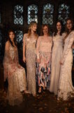 Designer Claire Pettibone and models posing during the Claire Pettibone Four Seasons Collection Showcase. NEW YORK, NY - SEPTEMBER 19: Designer Claire Pettibone Stock Photo