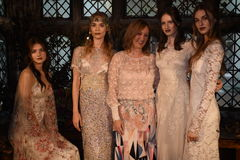 Designer Claire Pettibone and models posing during the Claire Pettibone Four Seasons Collection Showcase Stock Photos