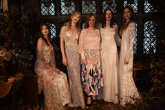 Designer Claire Pettibone and models posing during the Claire Pettibone Four Seasons Collection Showcase. NEW YORK, NY - SEPTEMBER 19: Designer Claire Pettibone Stock Photography