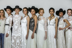 Designer Claire Pettibone poses with models at the Claire Pettibone Bridal SS 2016 Runway Show Royalty Free Stock Images