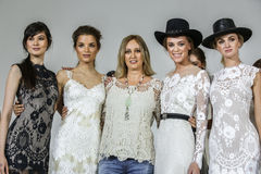 Designer Claire Pettibone poses with models at the Claire Pettibone Bridal SS 2016 Runway Show Stock Photos