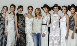 Designer Claire Pettibone poses with models at the Claire Pettibone Bridal SS 2016 Runway Show Stock Photography