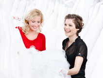 Designer and the client. Have a good look at the wedding dress preparing to try it on royalty free stock photography
