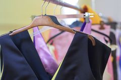 Designer clothes lined up stock photo