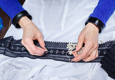 Designer clothes to choose jewelry for clothes Stock Image