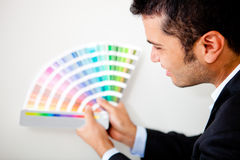 Designer with a color palette Stock Images